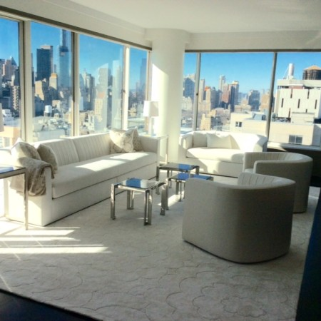 The skyline of Manhattan is the focus here, so I used soft beige and off white tones in leather, suede and appliquéd cashmeres to set the tone.  A custom designed rug with cloud motifs completes the look.