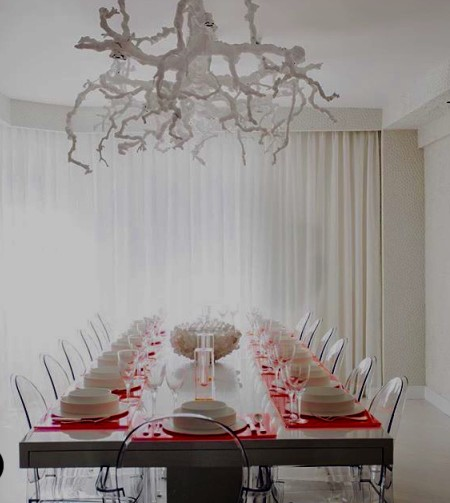 A Manhattan modern dining room with an edge! A custom grape vine chandelier by The Alpha Workshops.