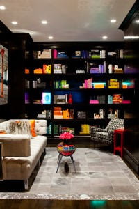 "Dark Walnut is the background while custom colored books and neon art makes this small room really ""POP""!"